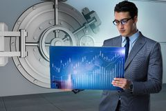 The businessman with touchscreen in financial banking concept. Businessman with touchscreen in financial banking concept Stock Images