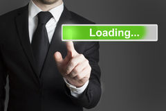 Businessman touchscreen loading bar Royalty Free Stock Image