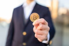 Businessman trader holding Bitcoin cryptocurrency. royalty free stock images