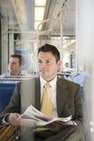 Businessman on train royalty free stock image