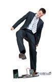 Businessman trampling foot motherboard Royalty Free Stock Images