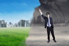 Businessman transforming environmental friendly city Royalty Free Stock Photo