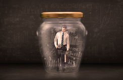 Businessman traped in jar with graph chart symbols concept Stock Photos