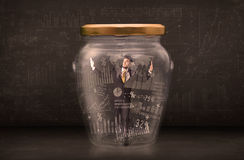 Businessman traped in jar with graph chart symbols concept Stock Photography