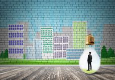 Businessman trapped in bulb royalty free stock photo