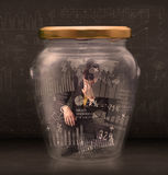 Businessman trapped into a glass jar concept Stock Image