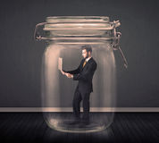 Businessman trapped into a glass jar concept Royalty Free Stock Photos