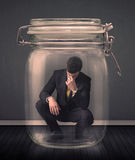 Businessman trapped into a glass jar concept Stock Photos