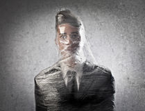 Businessman Trapped in the Plastic. Royalty Free Stock Photography
