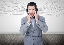 Businessman trapped by telephone wires Royalty Free Stock Photography