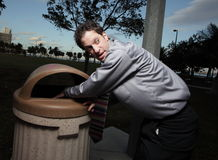 Businessman in the trash Stock Images