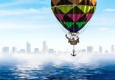 Businessman travel on air balloon stock photography