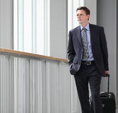 Businessman travel with trolley look forward. Businessman travel with trolley look out through the windows Royalty Free Stock Photography