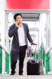 Businessman traveler journey business travel and talking phone. Royalty Free Stock Images