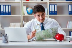 The businessman traveling agent working in the office Royalty Free Stock Photo