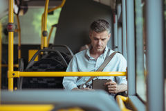 Businessman traveling by bus stock photos