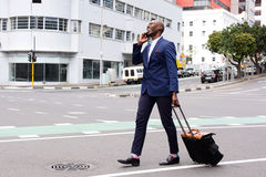 Businessman traveling and talking on cell phone Royalty Free Stock Photo