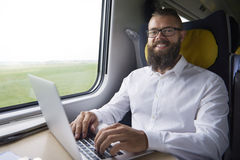 Businessman traveling by train Stock Images