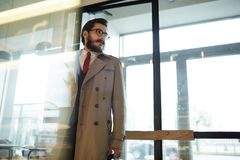 Businessman in trenchcoat Royalty Free Stock Photo