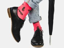 Businessman, trendy shoes, jeans and bright socks royalty free stock images