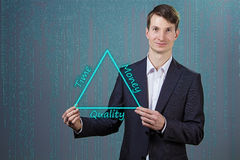 Businessman with triangle in his hands Stock Photos