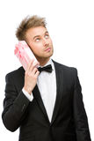 Businessman tries to hear something in present box Stock Image