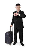 Businessman on trip checking time Stock Images