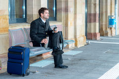 Businessman on trip has a break Stock Image