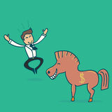 Businessman and a Trojan horse. Royalty Free Stock Photo