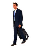 Businessman with trolley Stock Images