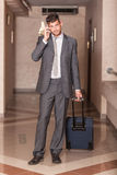 Businessman with Trolley. Businessman ready to Depart with Trolley Royalty Free Stock Photos