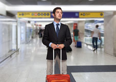 Businessman with trolley bag Royalty Free Stock Photos