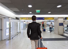 Businessman with trolley bag Stock Image