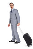 Businessman with a trolley being surprised Stock Image