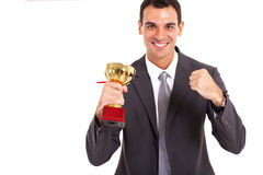 Businessman with trophy Royalty Free Stock Images