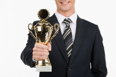 Businessman with trophy. Stock Photo