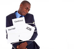 Businessman in trouble. African american businessman in deep trouble being tied with contract job and marriage Stock Photos