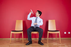 Businessman trowing paper planes. At home stock photo