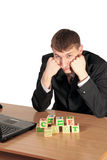 Businessman try compose blocks with a letters Stock Photo