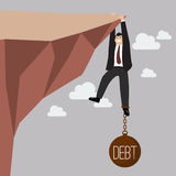 Businessman try hard to hold on the cliff with debt burden Stock Photos