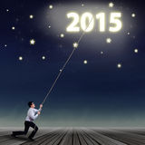 Businessman try to hold 2015 Stock Images