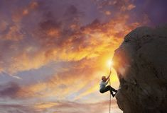 Businessman try to reach the goal. Difficult career concept. Businessman climbs a mountain to get the flag. Achievement business goal and Difficult career stock image