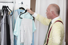 Businessman trying on clothes Stock Photography