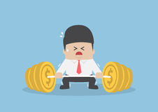 Businessman trying hard to lifting up barbell with coin weight Royalty Free Stock Photo