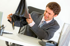 Businessman trying shakes out everything from case Stock Photos