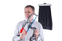 Businessman trying to cut his tie Stock Photos