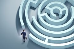 The businessman is trying to escape from maze labyrinth. Businessman is trying to escape from maze labyrinth Stock Photography