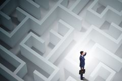 The businessman is trying to escape from maze labyrinth Stock Image