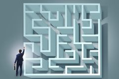 The businessman is trying to escape from maze labyrinth Stock Images