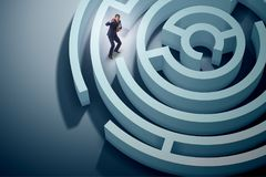 The businessman is trying to escape from maze labyrinth. Businessman is trying to escape from maze labyrinth Royalty Free Stock Image